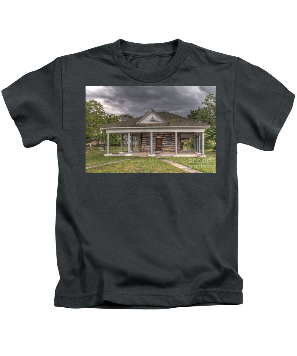 2015 Kids T-Shirt featuring the photograph Concorida Log Cabin College by Larry Braun