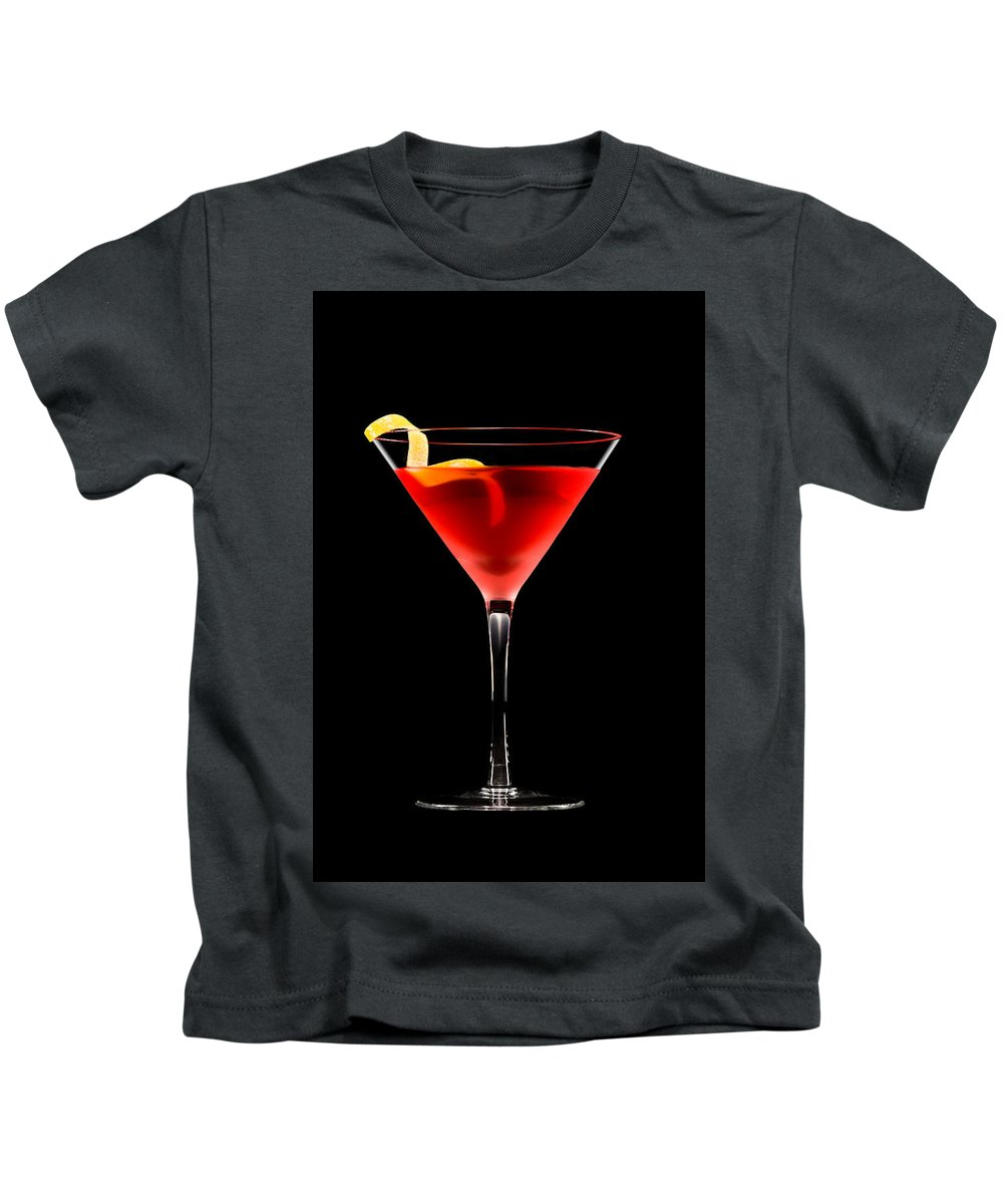 Alcohol Kids T-Shirt featuring the photograph Cosmopolitan Cocktail In Front Of A Black Background by U Schade