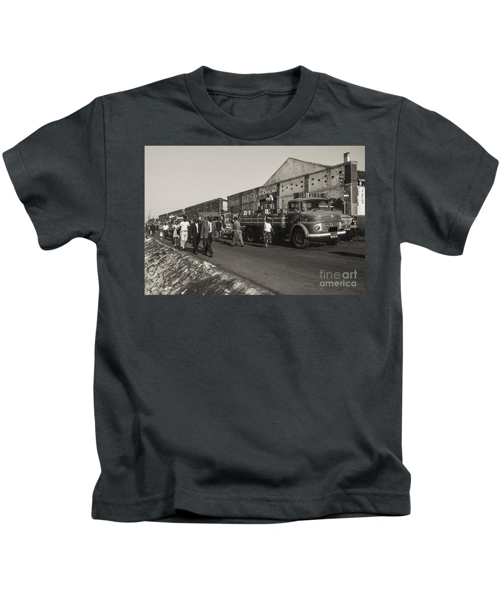 Lisbon Portuguese Republic Portugal Men Man Woman Women People Person Persons Creature Creatures Dock Workers Docks Worker Truth Trucks Warehouse Warehouses Cityscape Cityscapes City Cities Black And White Sepia Kids T-Shirt featuring the photograph Dock Workers 3 by Bob Phillips