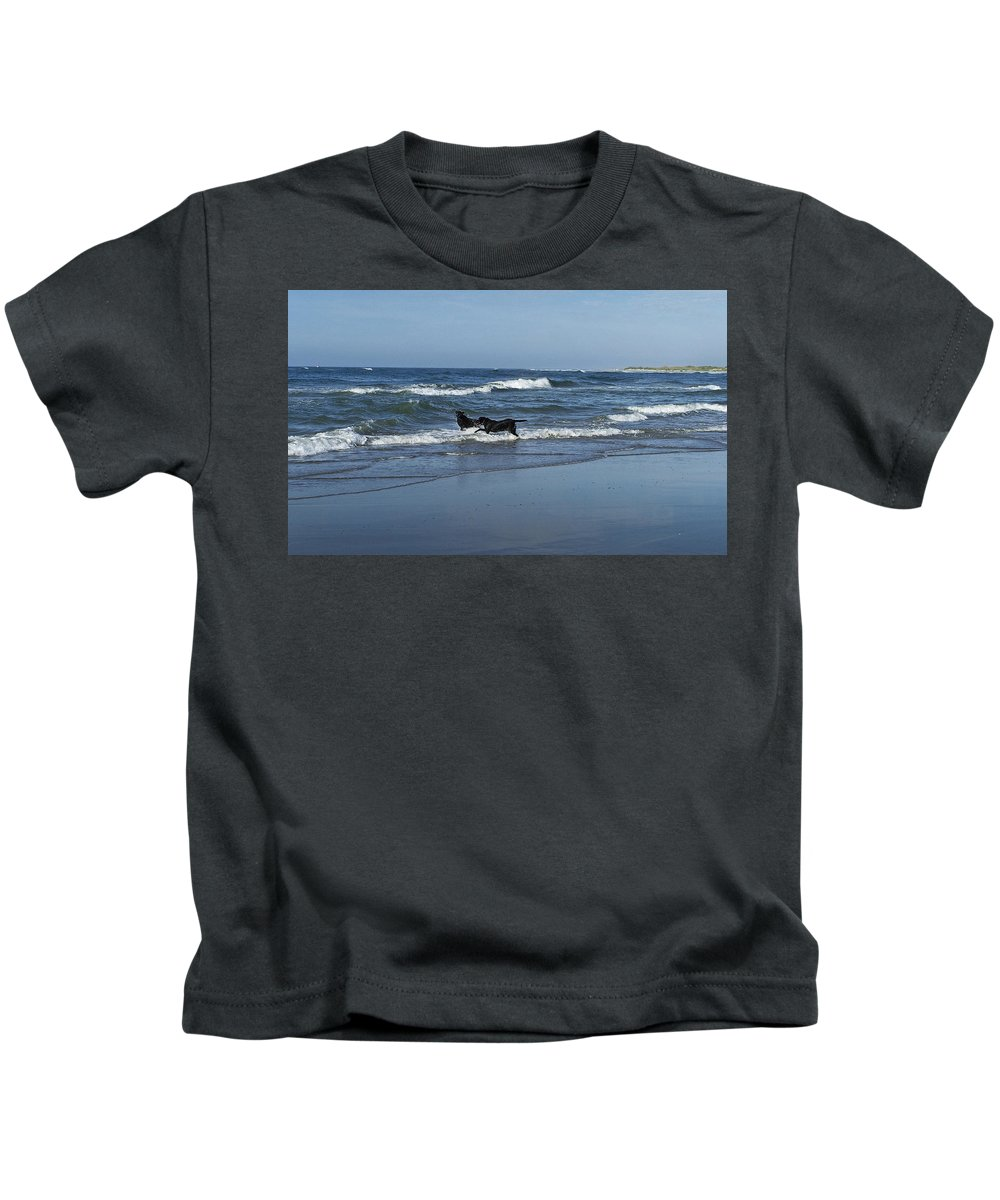 Dog Kids T-Shirt featuring the photograph Dogs In The Surf by Teresa Mucha