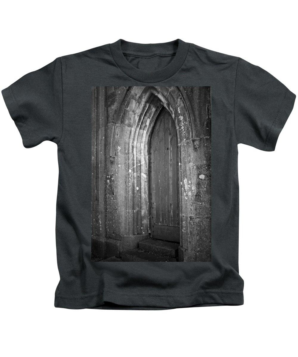 Irish Kids T-Shirt featuring the photograph Door At Protestant Church Macroom Ireland by Teresa Mucha