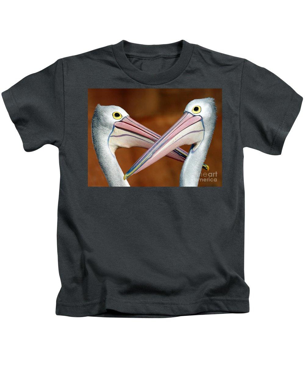 Duelling Pelicans Bird Australia Seabird Kids T-Shirt featuring the photograph Duelling pelicans by Sheila Smart Fine Art Photography