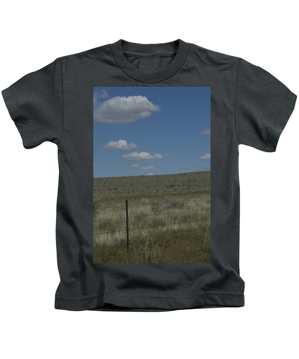 Fenced Kids T-Shirt featuring the photograph Fenced Clouds by Sara Stevenson