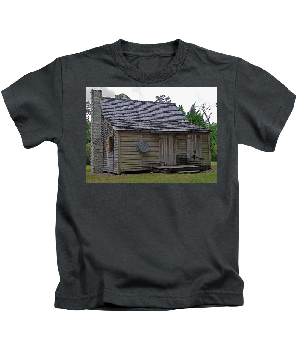 Cracker; Florida; Cabin; Rain; Light; Falls; 1900's; Farmer; Farm; Citrus; Oranges; Orlando; Mature; Kids T-Shirt featuring the photograph Florida Cracker Cabin Circa 1900 by Allan Hughes
