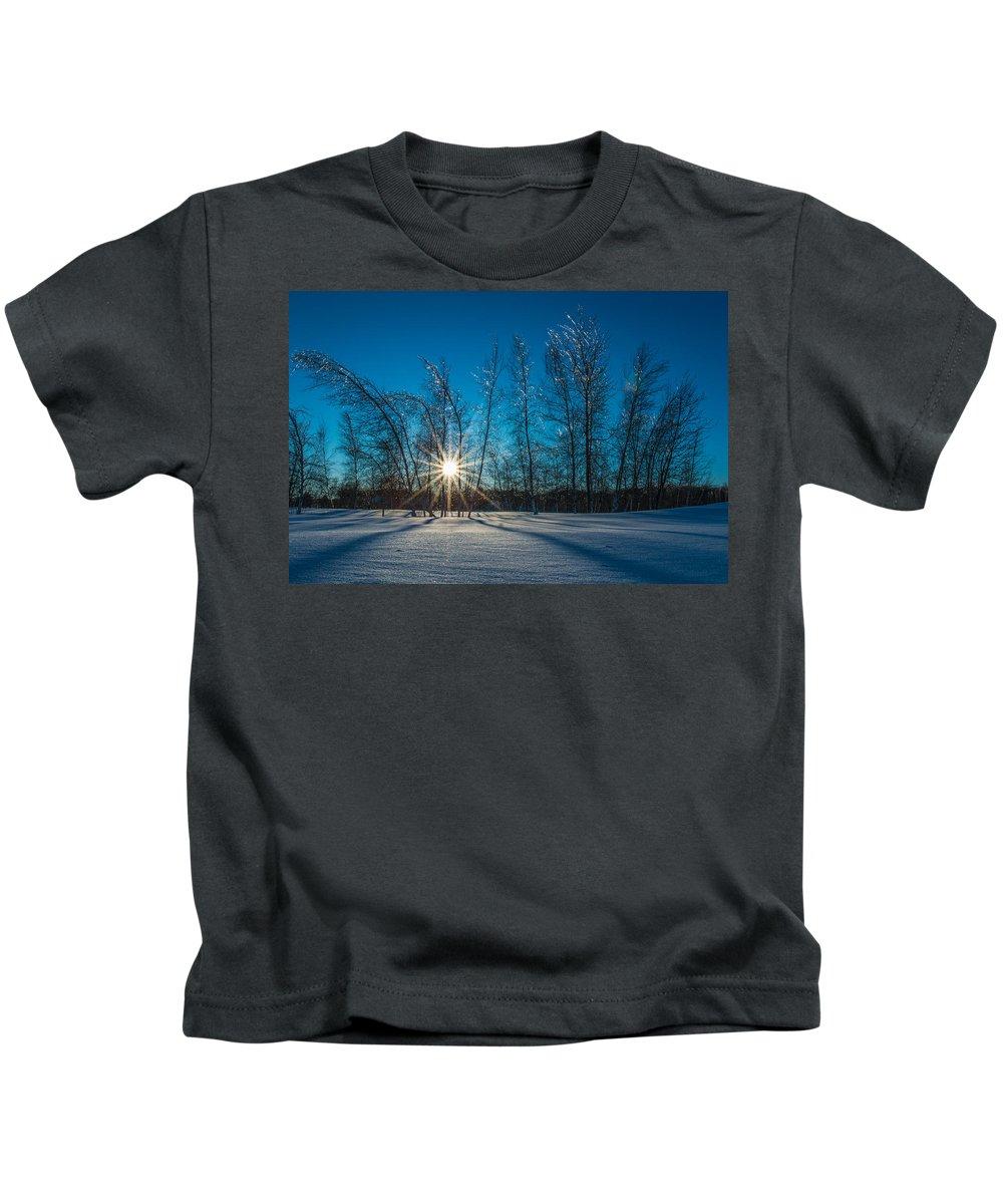 Winter Kids T-Shirt featuring the photograph Frozen Trees Under A Winter Sunset by Alex Papp