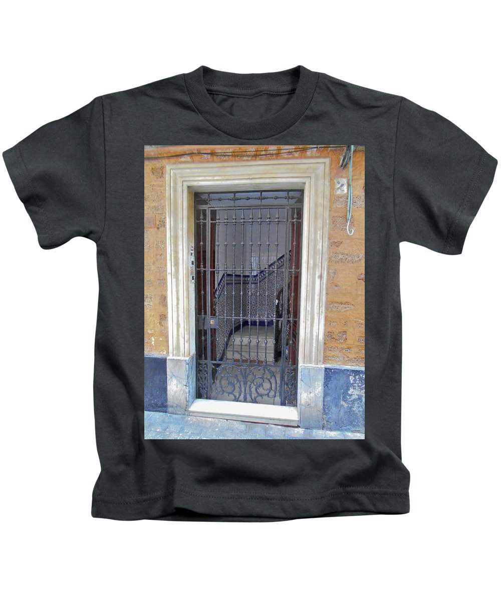 Landscape Kids T-Shirt featuring the photograph Gated Door Cadiz by Mark Victors