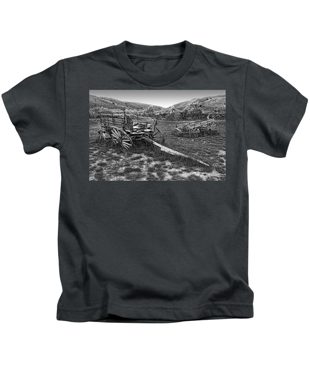 Wagons Kids T-Shirt featuring the photograph Ghost Wagons Of Bannack Montana by Daniel Hagerman