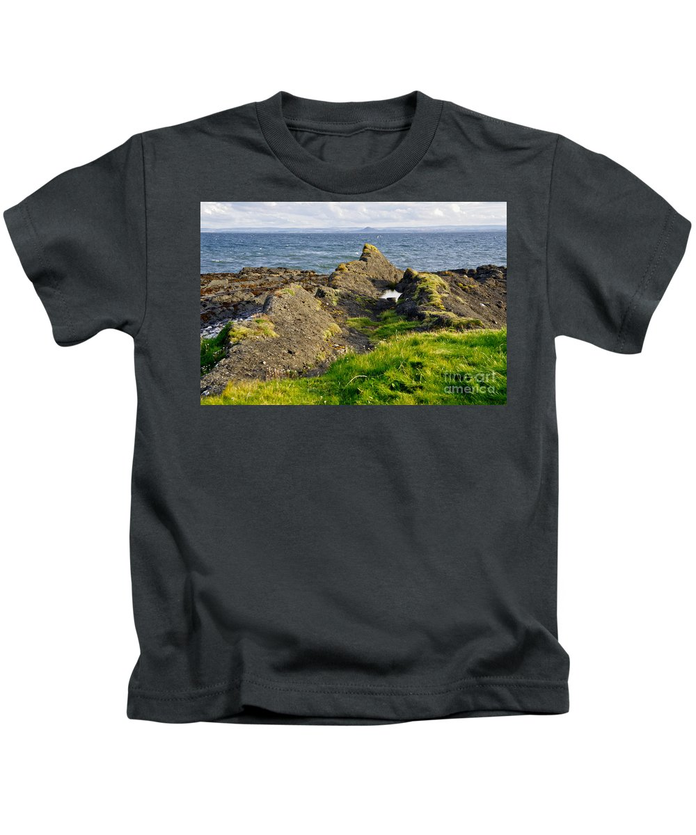 Rocks On The Seashore Kids T-Shirt featuring the photograph Guarding The Coast. by Elena Perelman