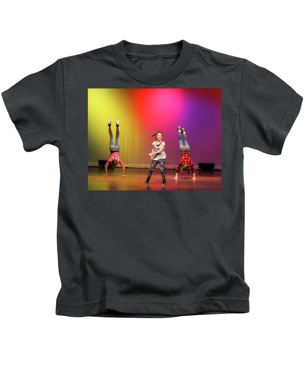 Events Kids T-Shirt featuring the photograph Heads Down Feet Up by Leigh Lofgren