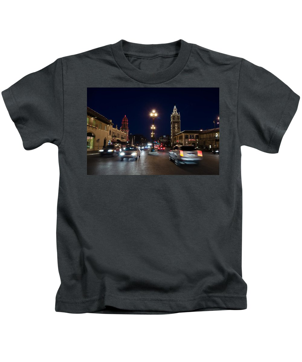 Architecture Kids T-Shirt featuring the photograph Holiday In Motion On The Plaza by John Diebolt