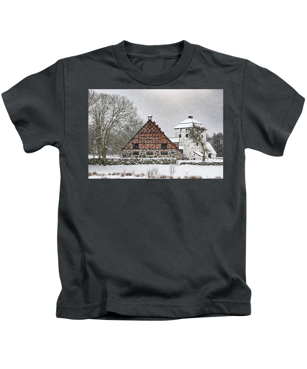 Winter Kids T-Shirt featuring the photograph Hovdala Castle Gatehouse And Stables In Winter by Antony McAulay