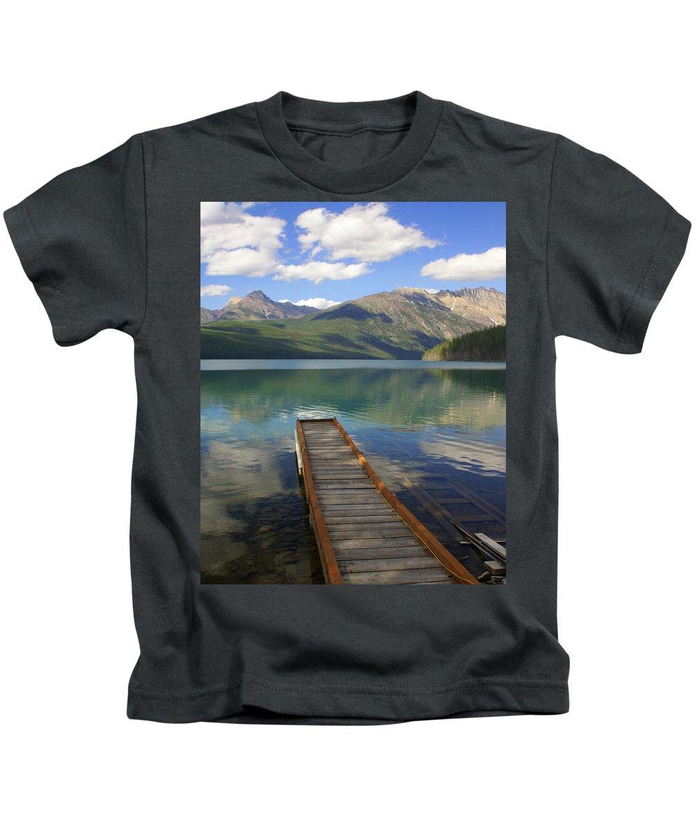 Glacier National Park Kids T-Shirt featuring the photograph Kintla Lake Dock by Marty Koch