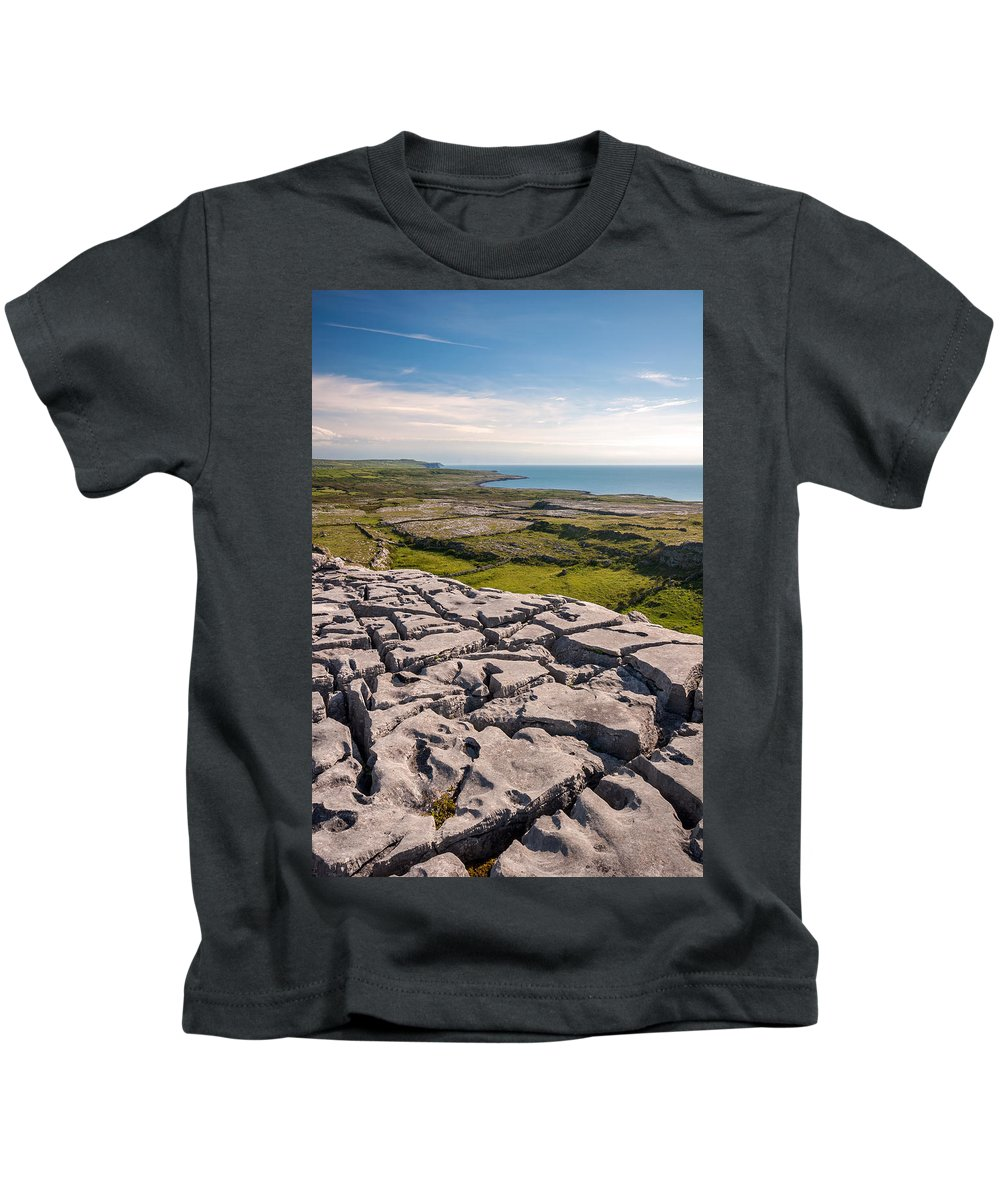 Ireland Kids T-Shirt featuring the photograph Limestone Landscape Of The Burren Ireland by Pierre Leclerc Photography