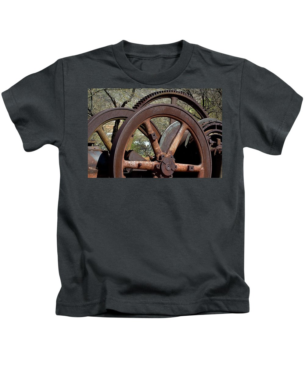 Wheels Kids T-Shirt featuring the photograph Many Wheels by Phyllis Denton