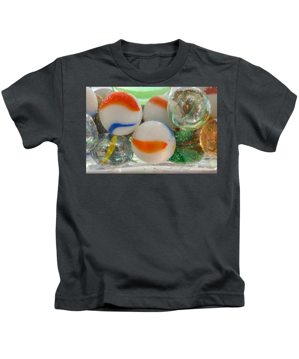 Marbles Kids T-Shirt featuring the photograph Marbelous by Donna Collins