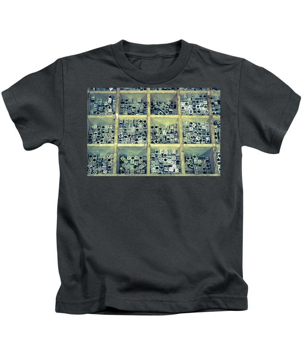 Beads Kids T-Shirt featuring the photograph Metallic Letter Beads For Name Necklaces In The Bead Store by Benyamin Shoham
