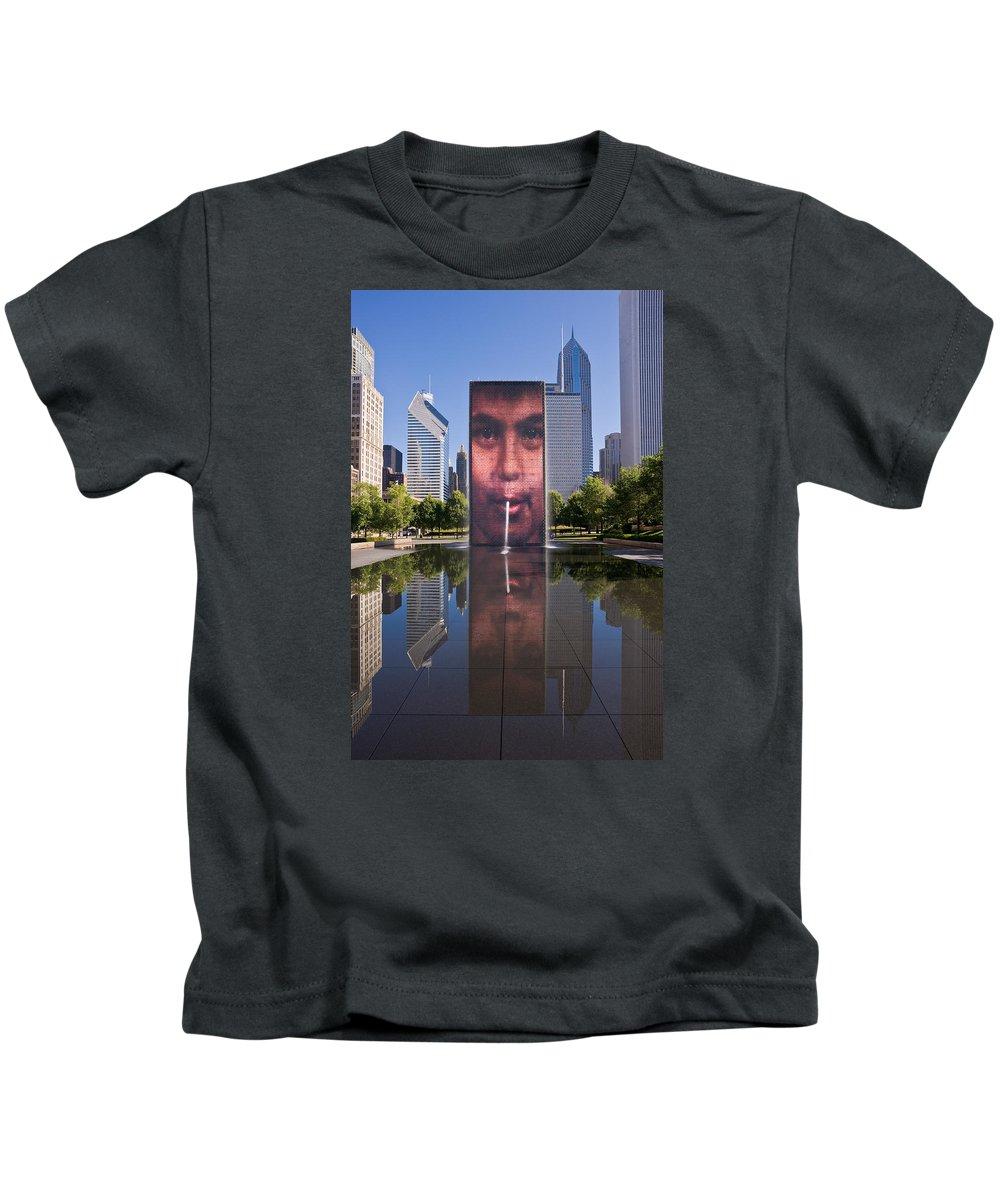 Art Kids T-Shirt featuring the photograph Millennium Park Fountain And Chicago Skyline by Steve Gadomski