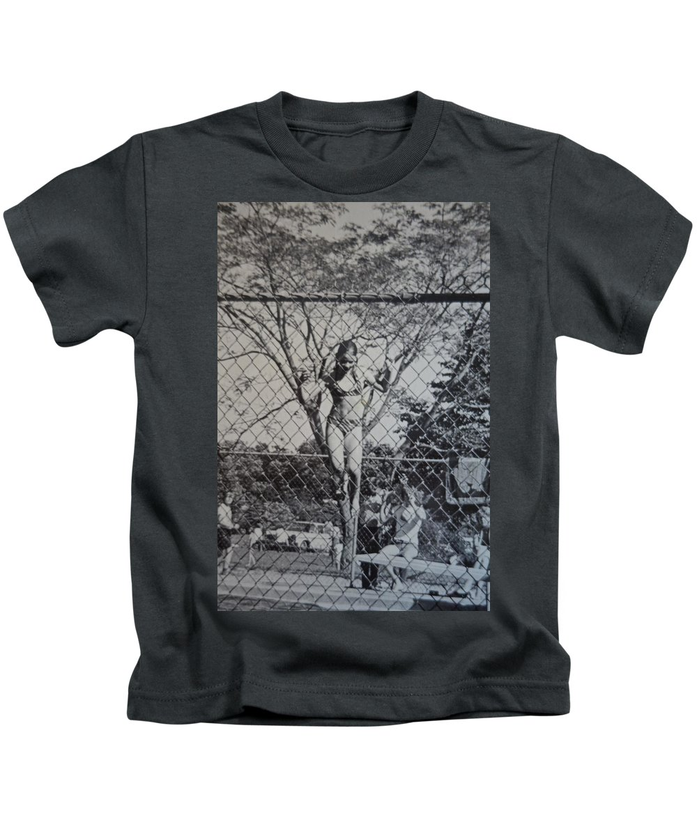 Camp Kids T-Shirt featuring the photograph Mimosa Girl Jumps In by Rauno Joks