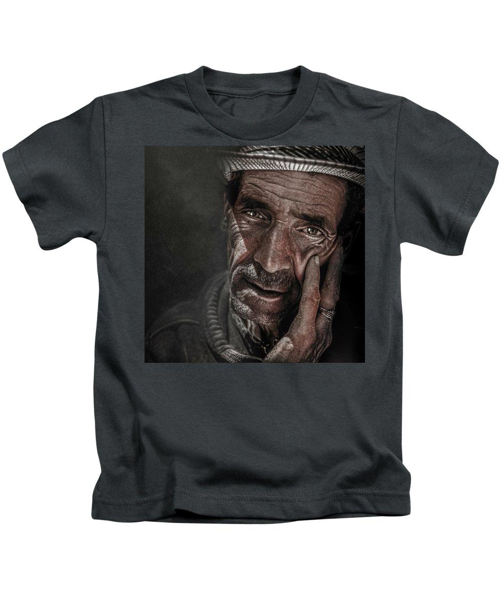 Man Kids T-Shirt featuring the photograph Miserable Life by Zouhir Elmessaoudi