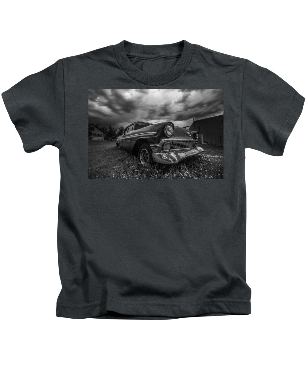 #black And White #trent #abandoned #art #b&w #beautiful #beauty #black #car #cell #chevrolet #chevy #chrome #clouds #dark #deay #monochrome #murica #old #sky #storm #street #summer #thunderstorm #travel Kids T-Shirt featuring the photograph mono CHROME by Aaron J Groen