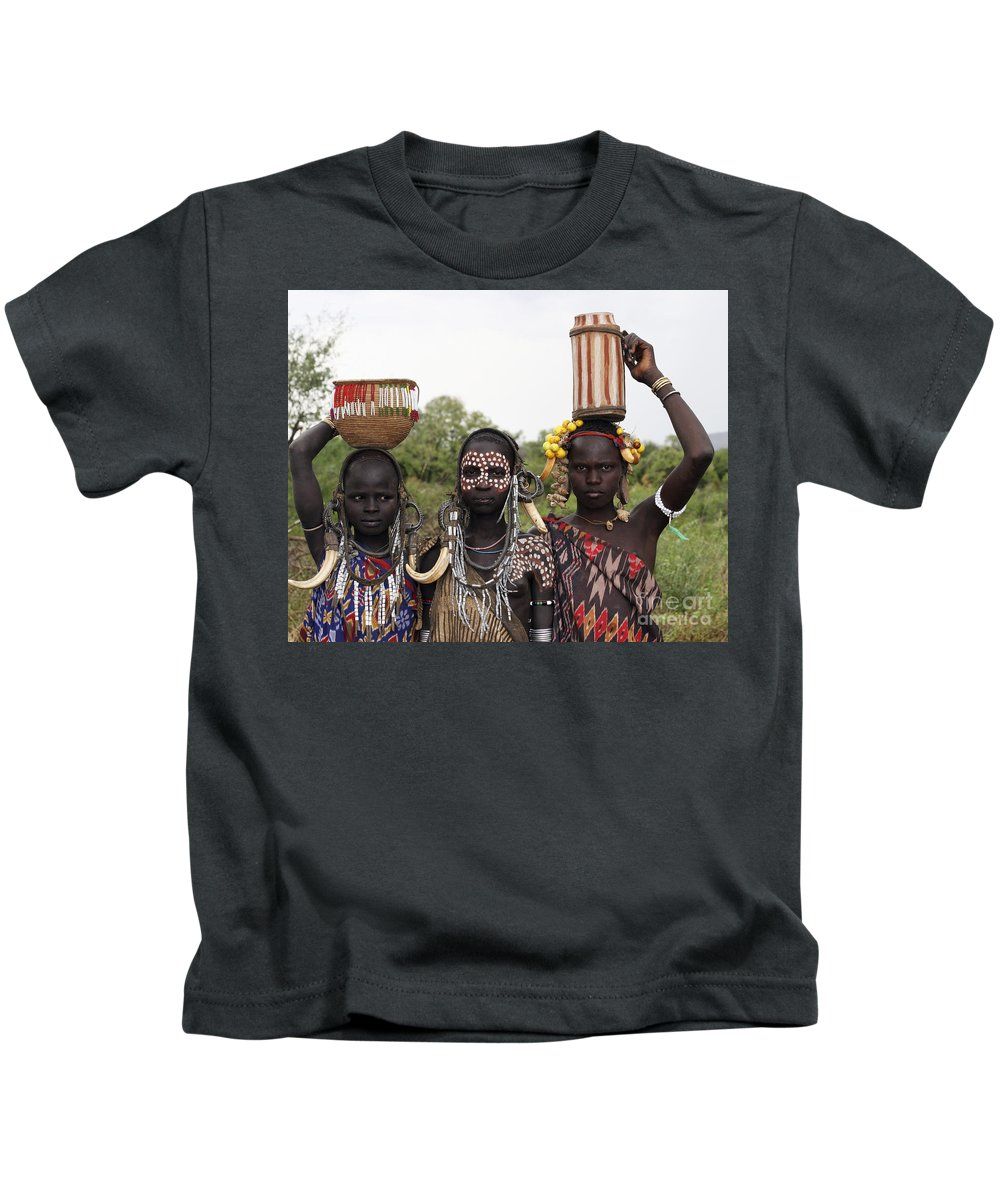 Ethiopia Kids T-Shirt featuring the photograph Mursi Tribesmen In Ethiopia by Gilad Flesch
