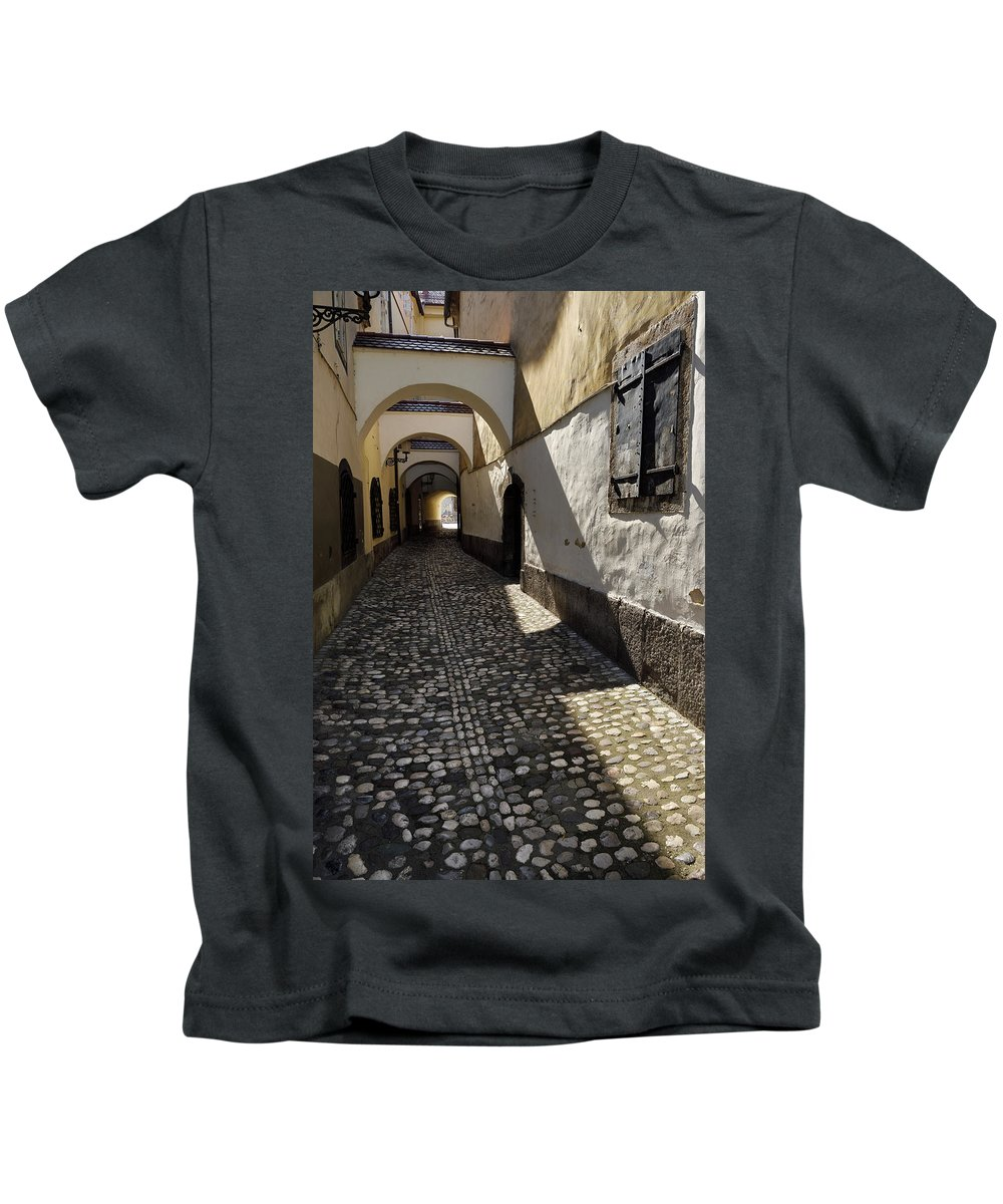 Narrow Kids T-Shirt featuring the photograph Narrow Cobblestone Alley Ribji Trg Or Fish Square From Cankar Qu by Reimar Gaertner