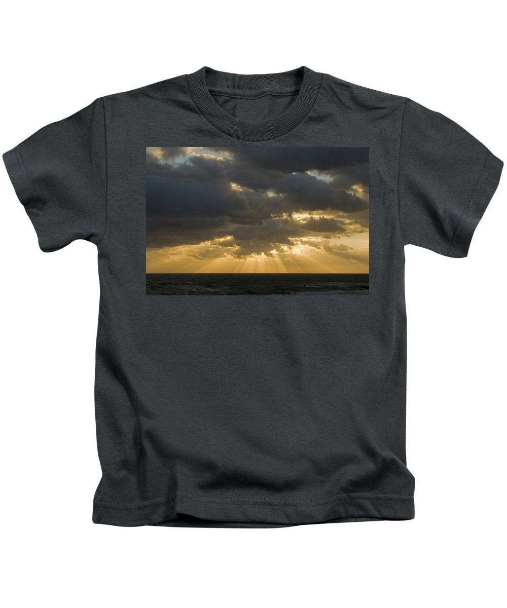 Ocean Sunset Sun Cloud Clouds Ray Rays Beam Beams Bright Wave Waves Water Sea Beach Golden Nature Kids T-Shirt featuring the photograph New Beginning by Andrei Shliakhau
