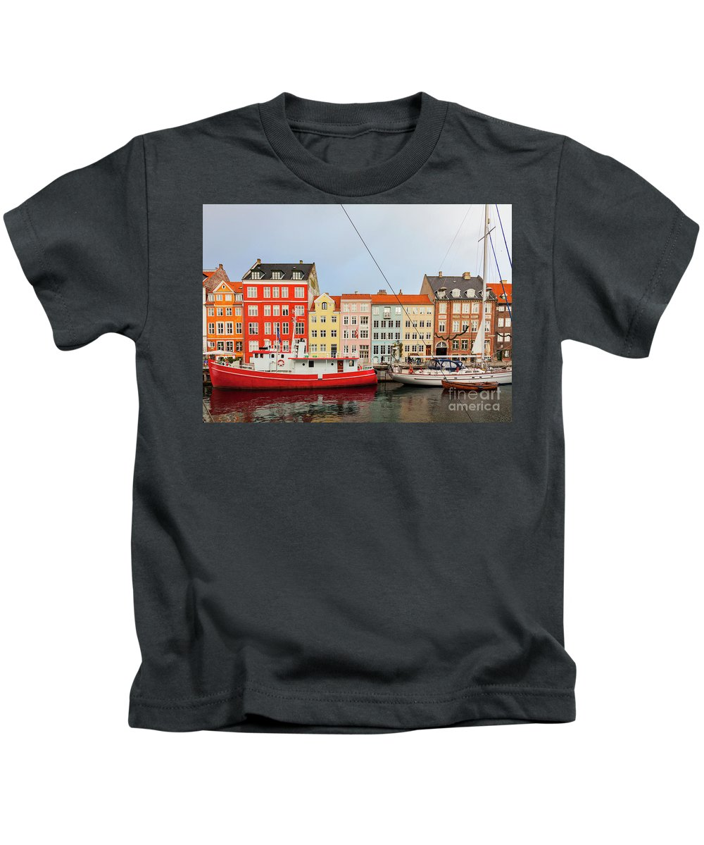 Christmas Kids T-Shirt featuring the photograph Nyhavn In Copenhagen Denmark by Sophie McAulay