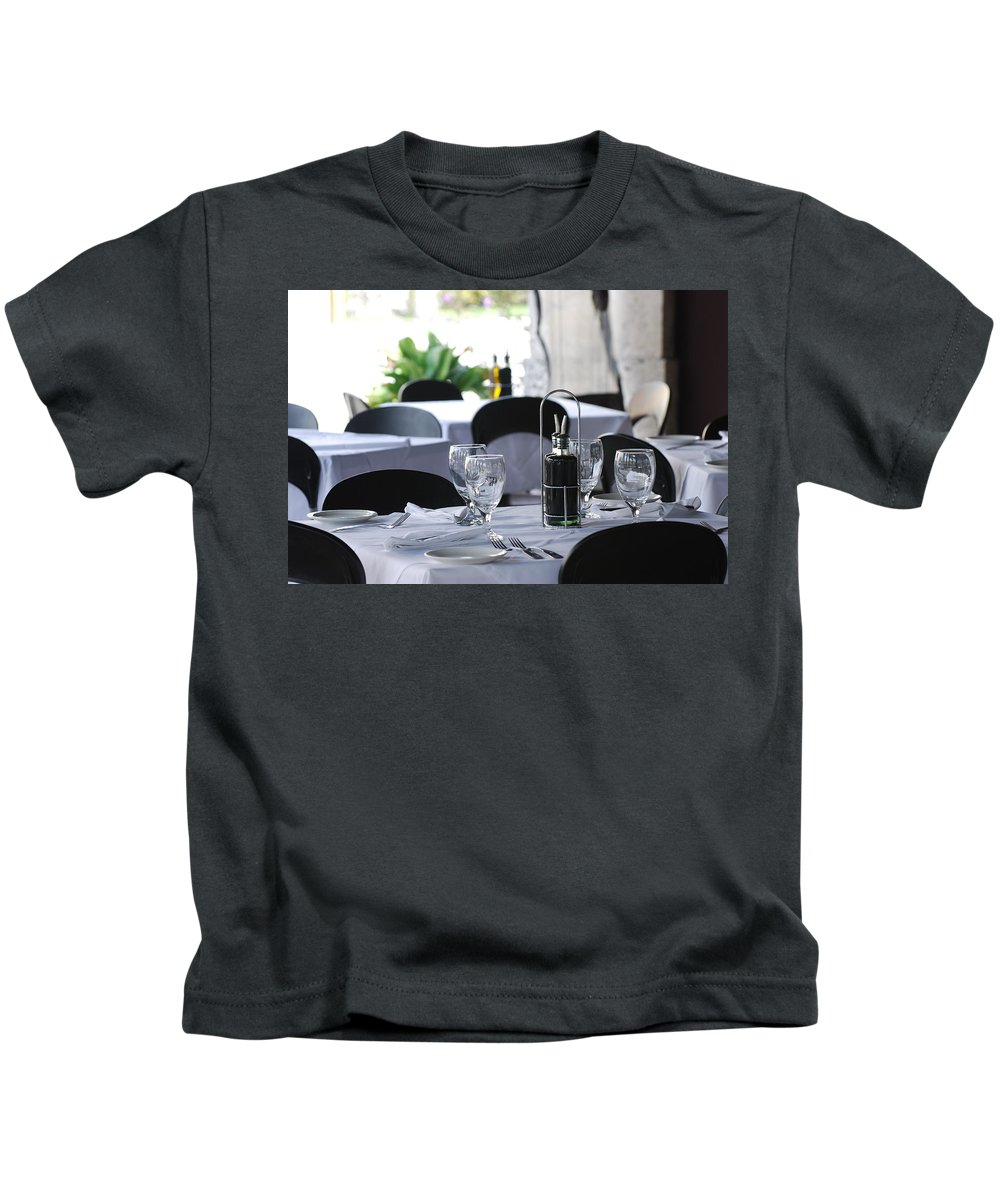 Tables Kids T-Shirt featuring the photograph Oils And Glass At Dinner by Rob Hans