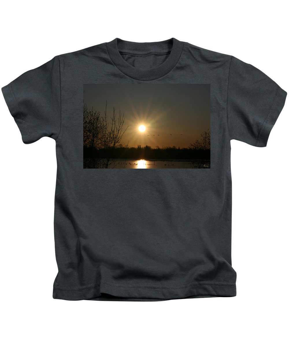 Geese Water Lake Ice Trees Nature Sunrise Sun Cold Morning Ducks Birds Kids T-Shirt featuring the photograph On Frozen Pond by Andrea Lawrence