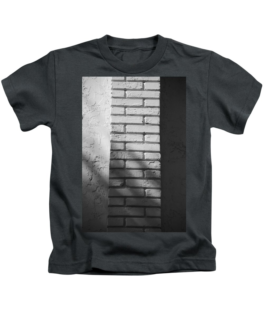 Black And White Kids T-Shirt featuring the photograph Outside The Wall by Rob Hans