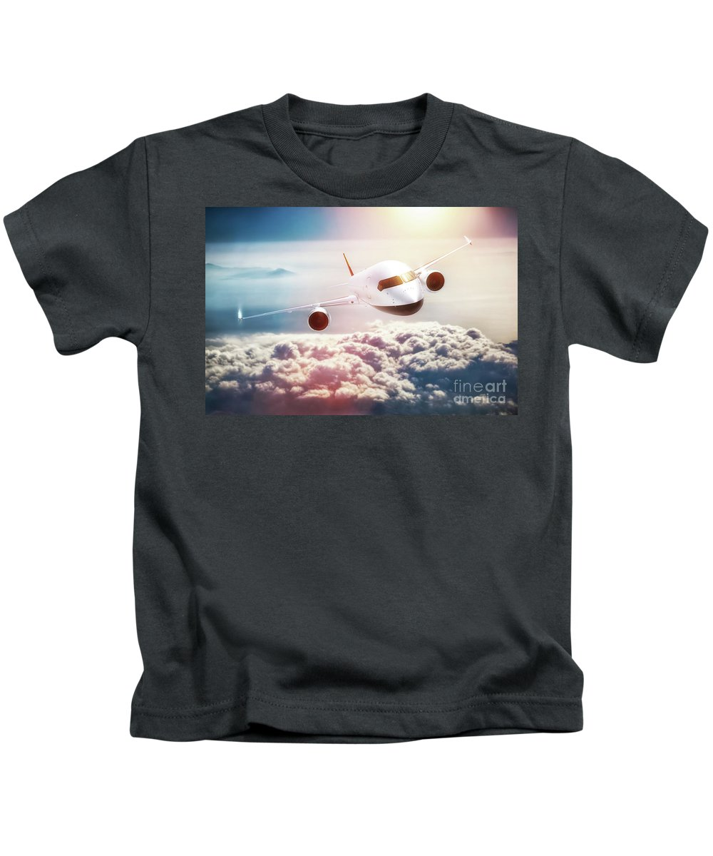 Airplane Kids T-Shirt featuring the photograph Passenger Airplane Flying At Sunset, Blue Sky. by Michal Bednarek