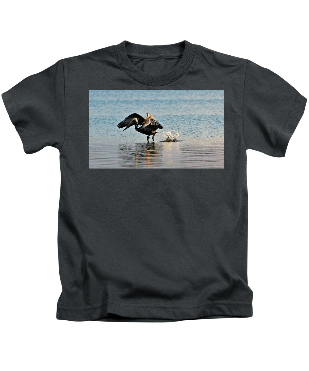 Pelican Kids T-Shirt featuring the photograph Pelican Landing by Kelly Foreman