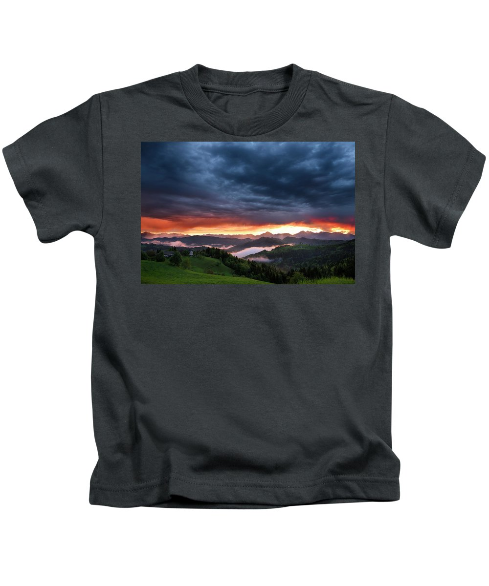 Sunrise Kids T-Shirt featuring the photograph Pink Sunrise And Blue Clouds In The Mountains Of Kamnik Savinja by Reimar Gaertner