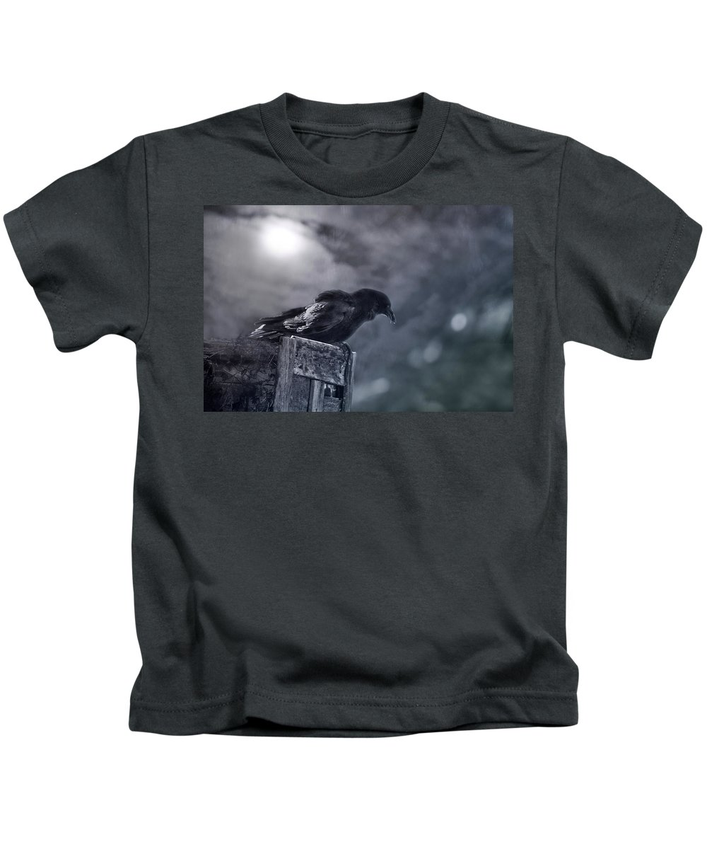 Raven Kids T-Shirt featuring the photograph Raven Twilight by Susan Capuano