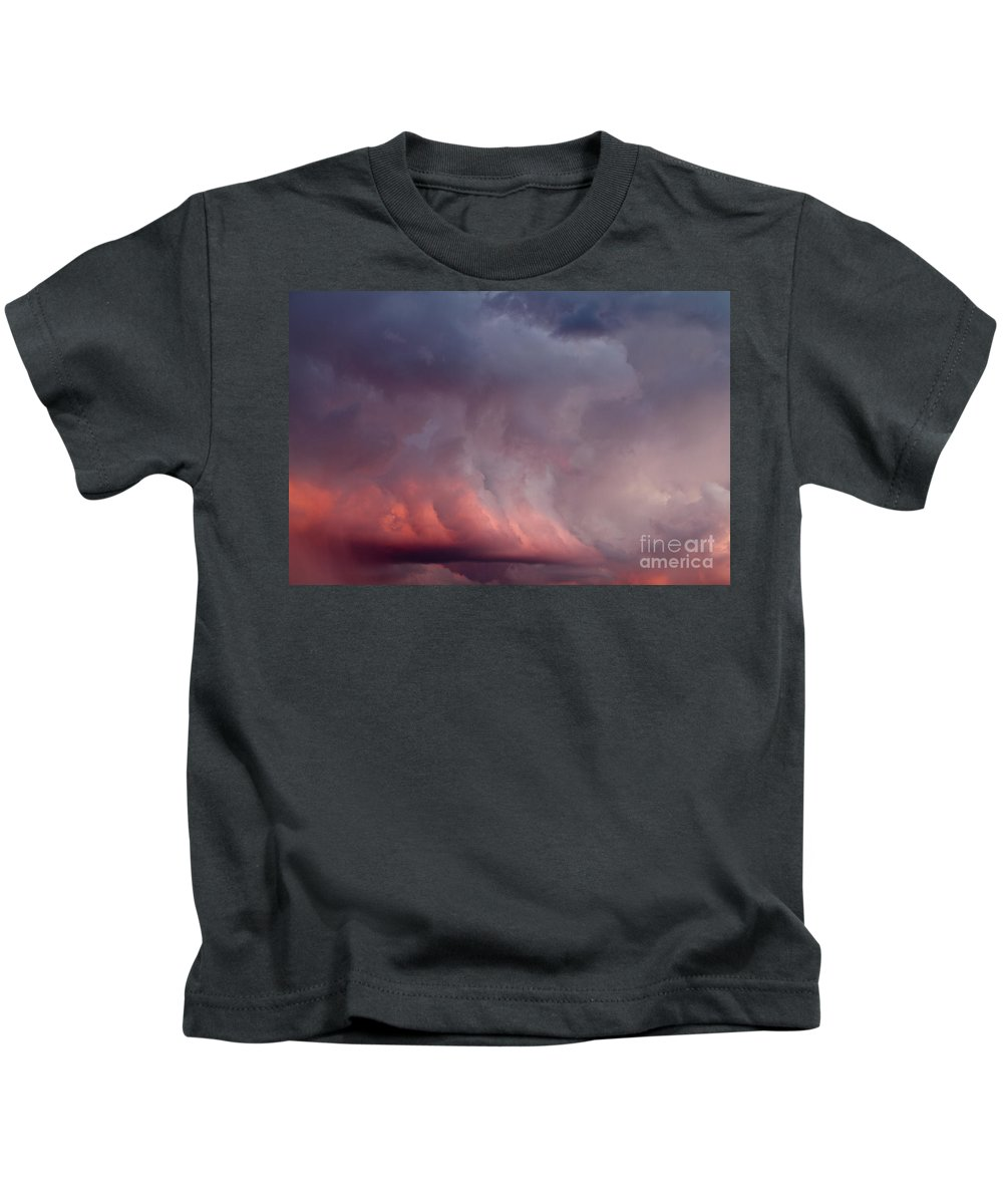 Afterglow Kids T-Shirt featuring the photograph Red Clouds On The Evening Sky by Dan Radi