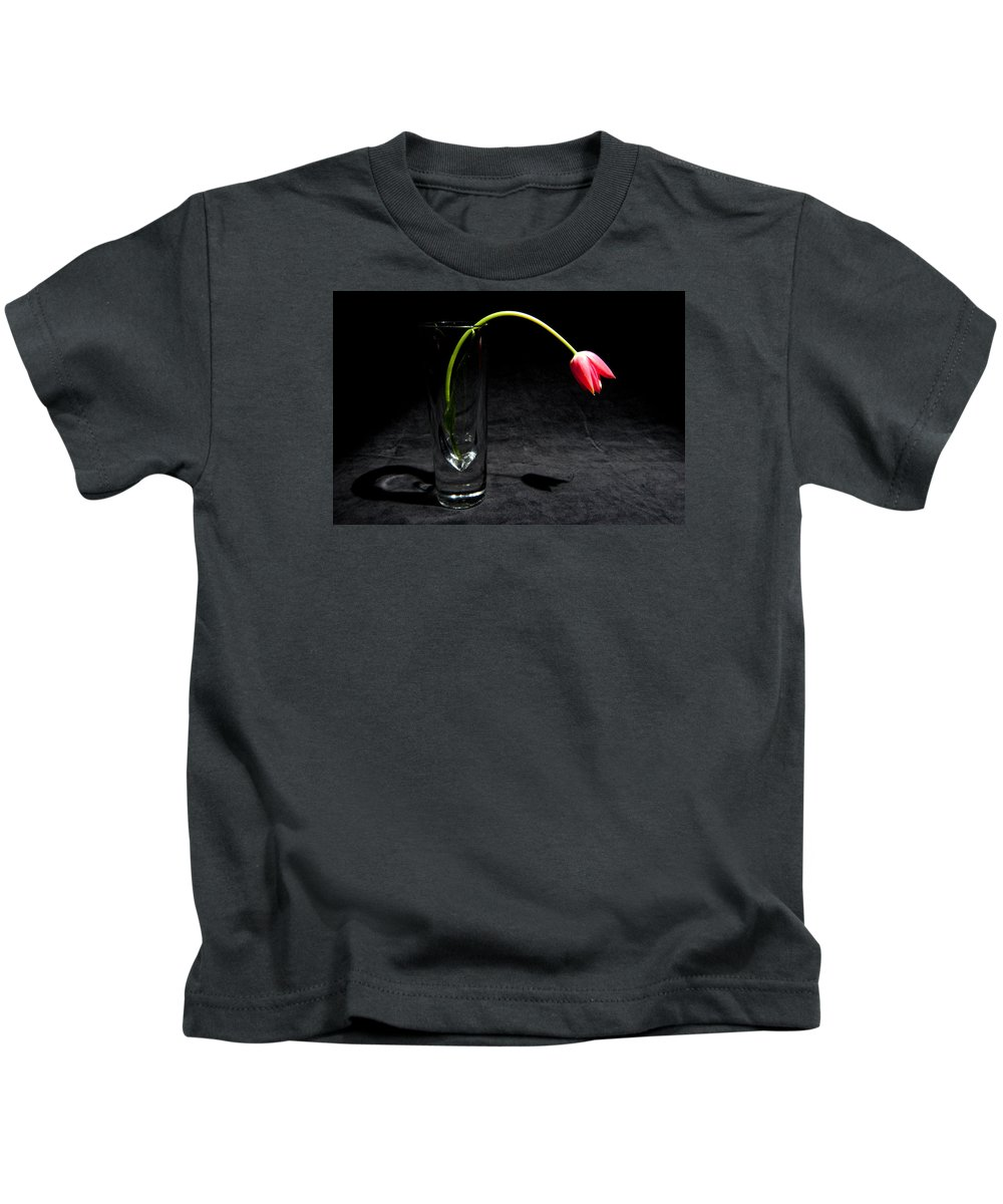 Black Kids T-Shirt featuring the photograph Red Tulip On Black by Helen Northcott