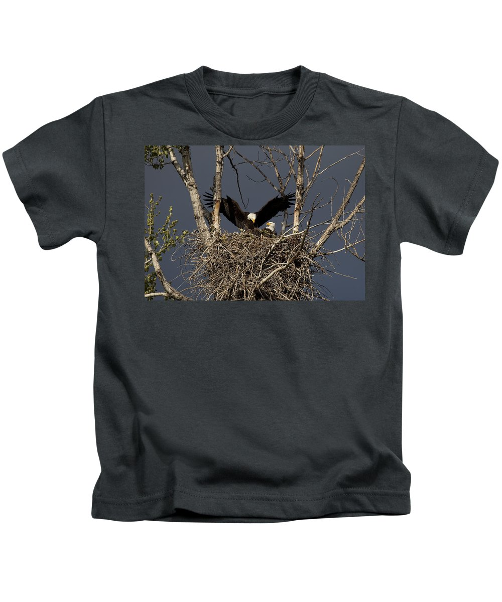 Eagle Kids T-Shirt featuring the photograph Returning Home To The Nest by Mike Dawson