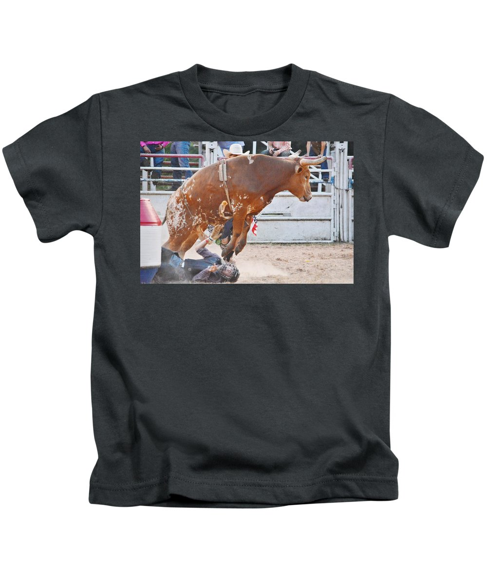 Cows Kids T-Shirt featuring the photograph Rodeo by Kenneth Greathouse