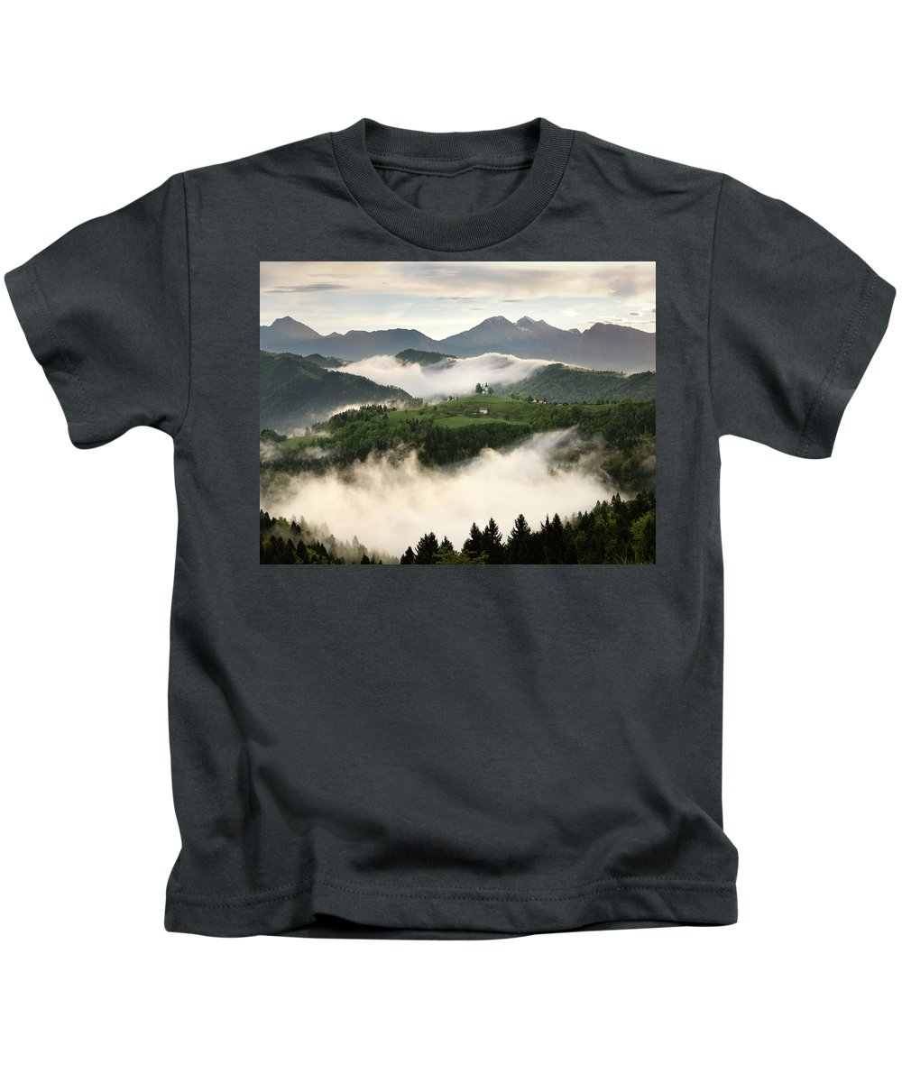Sunrise Kids T-Shirt featuring the photograph Rolling Fog At Sunrise With Mountains Of Kamnik Savinja Alps At by Reimar Gaertner