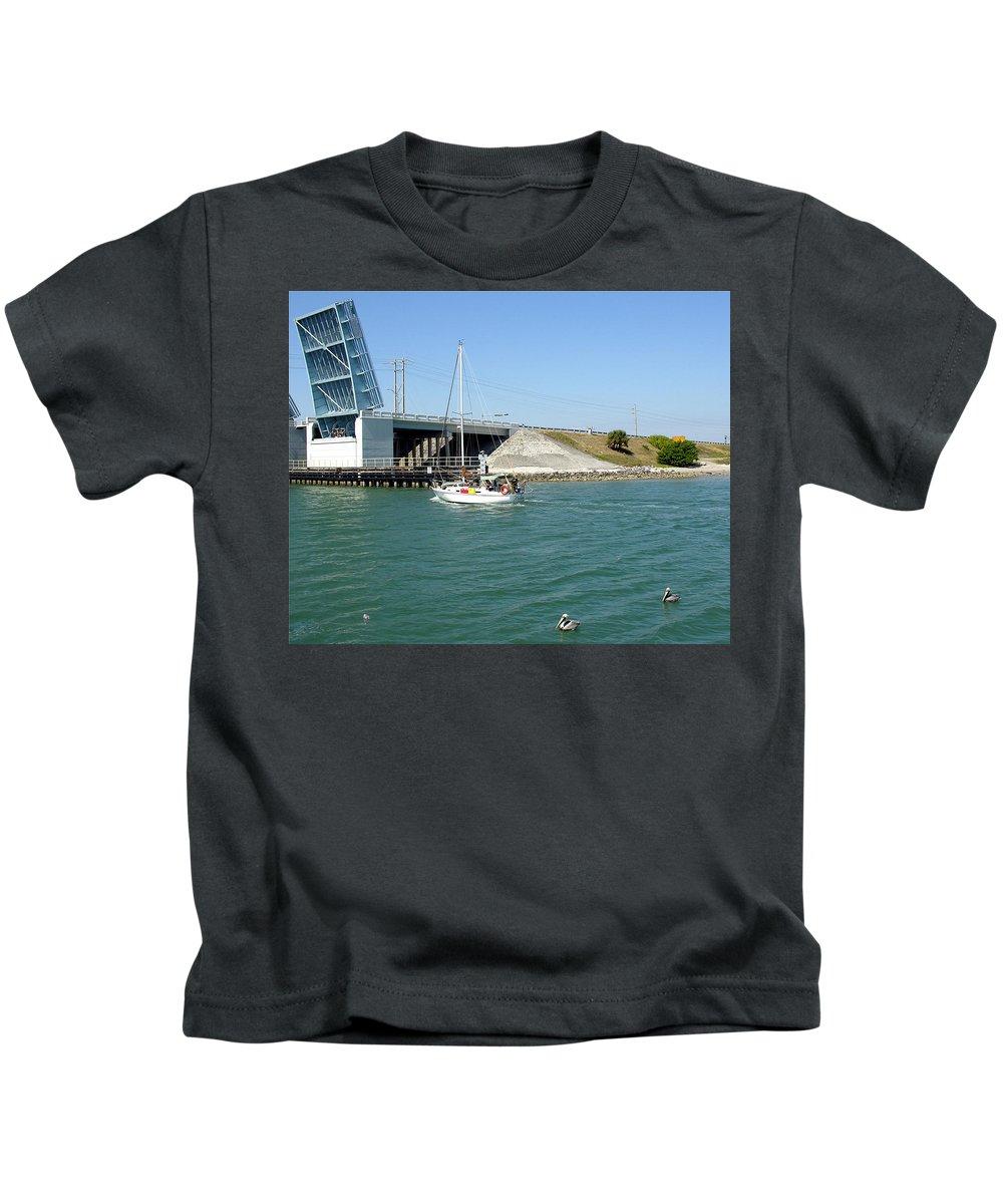 Port; Canaveral; Locks; Sail; Boat; Pelicans; Sailboat Drawbridge; Sailboat; Indian River; Indian; I Kids T-Shirt featuring the photograph Sailing In Port Canaveral Florida by Allan Hughes