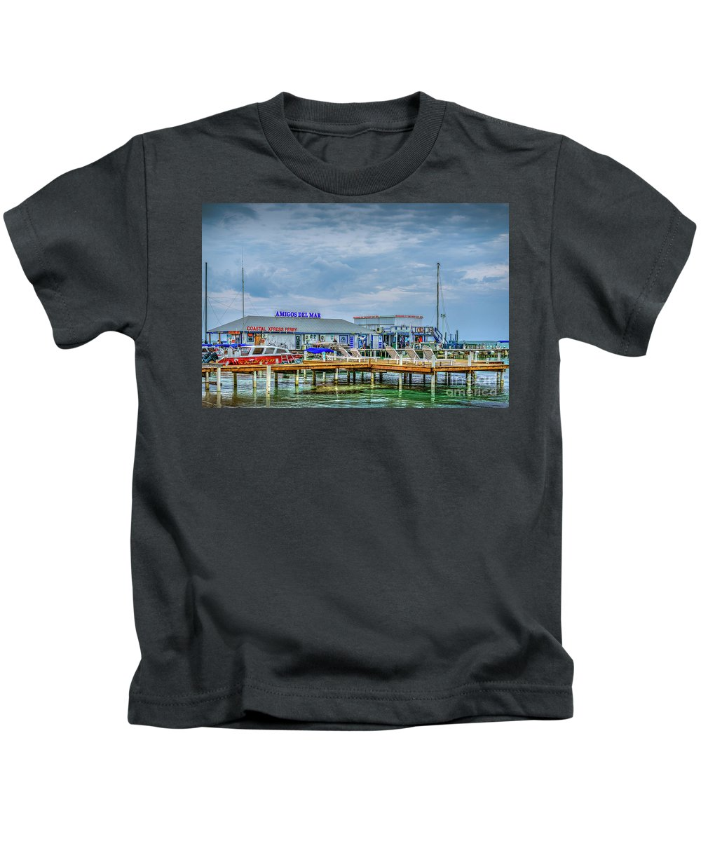 San Pedro Belize Kids T-Shirt featuring the photograph San Pedro Ambergris Caye Landing by David Zanzinger