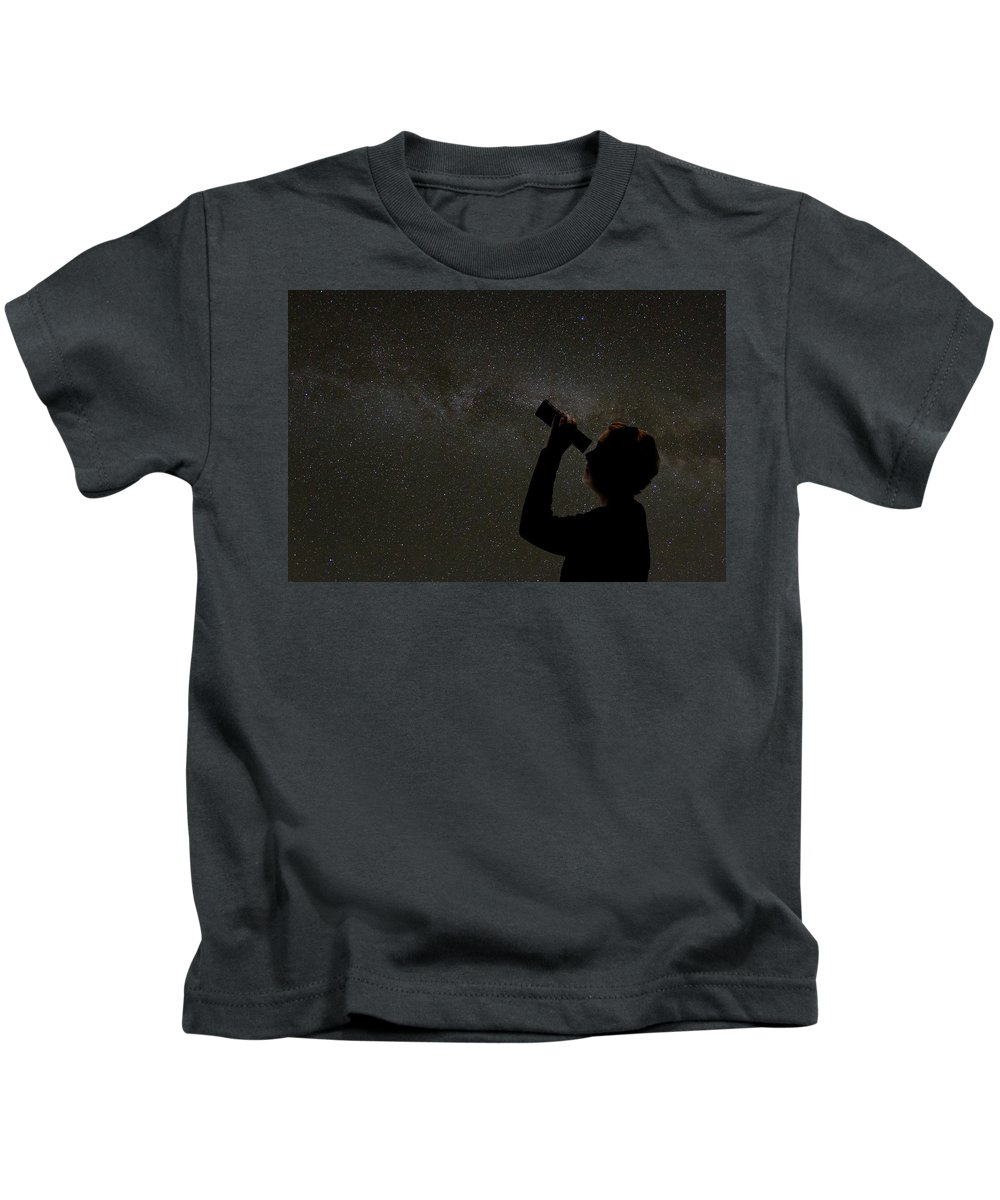Milky Way Kids T-Shirt featuring the photograph Silhouette Of Woman Looking At Stars by Karen Foley