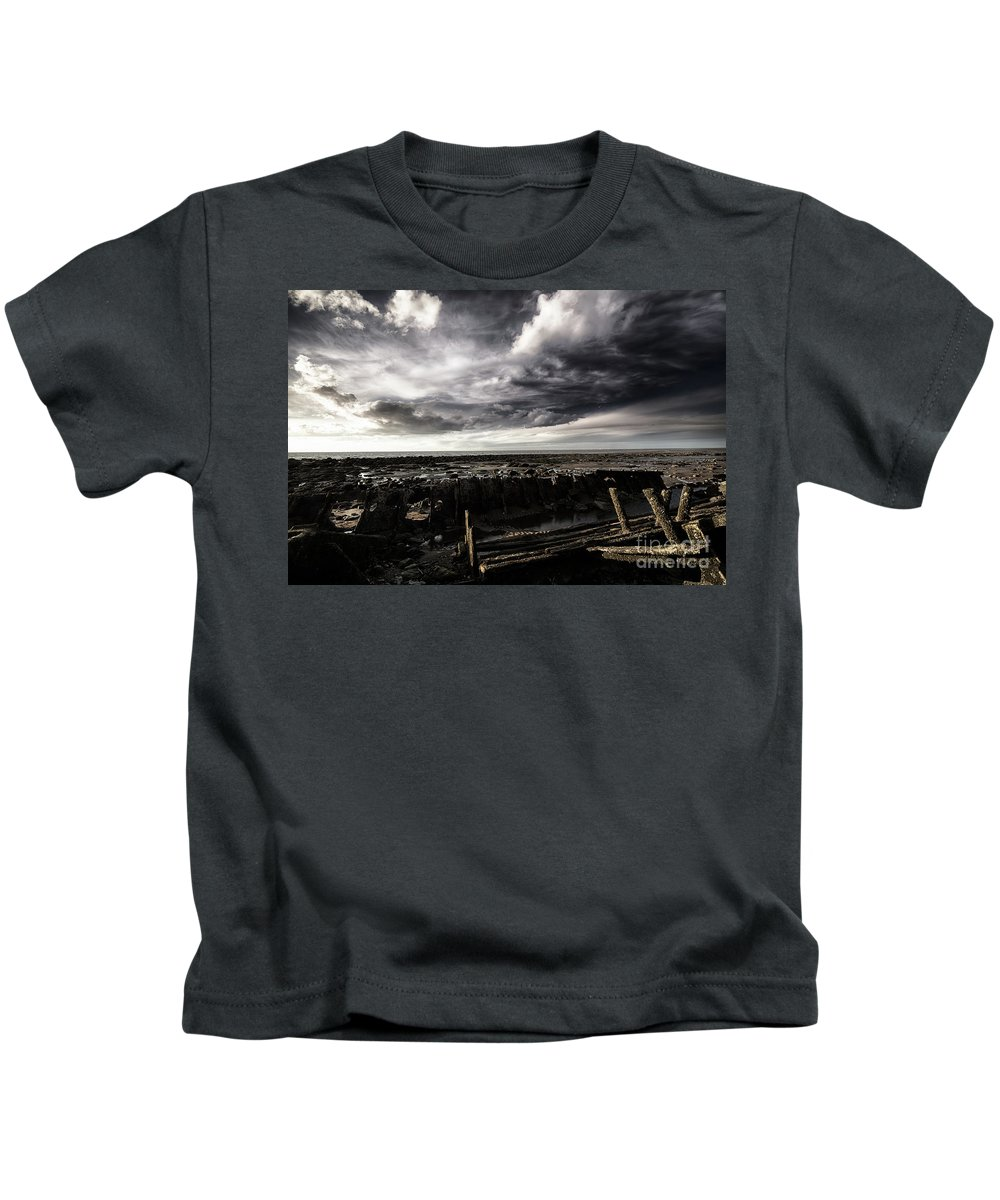Storm Kids T-Shirt featuring the photograph Storm Clouds Over Beached Shipwreck by Simon Bratt Photography LRPS