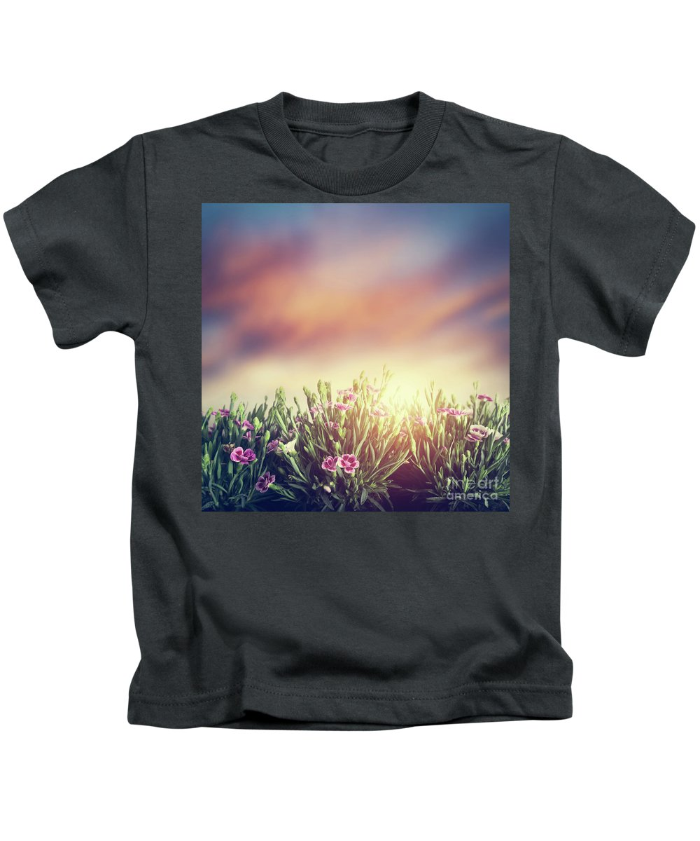 Grass Kids T-Shirt featuring the photograph Summer Meadow Flowers In Grass At Sunset. Vintage by Michal Bednarek