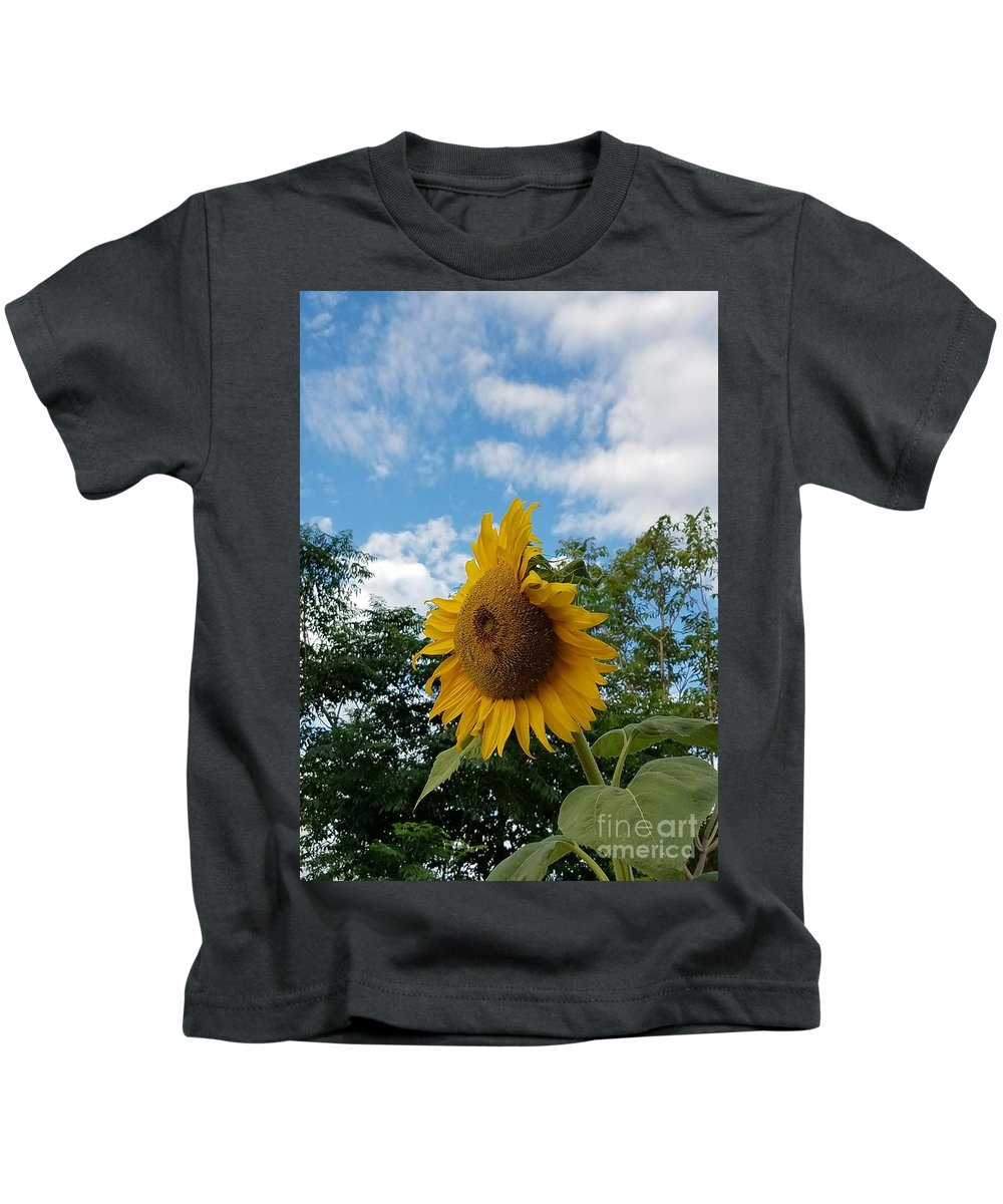 Helianthus Annuus Kids T-Shirt featuring the photograph Sun Power by Angela J Wright
