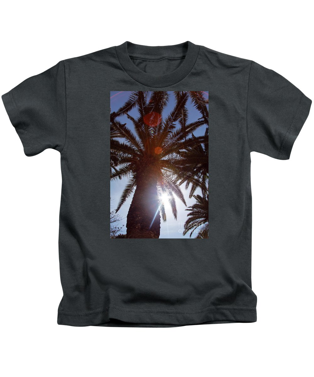 Landscape Kids T-Shirt featuring the photograph Sunbeams Through The Palms by Jacqueline Moore
