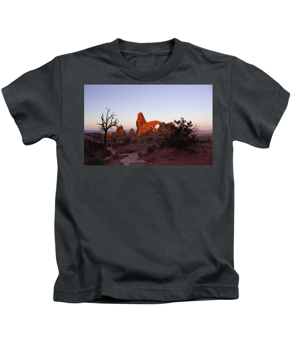 Tower Arch Kids T-Shirt featuring the photograph Sunrise at Tower Arch by Ellen Heaverlo