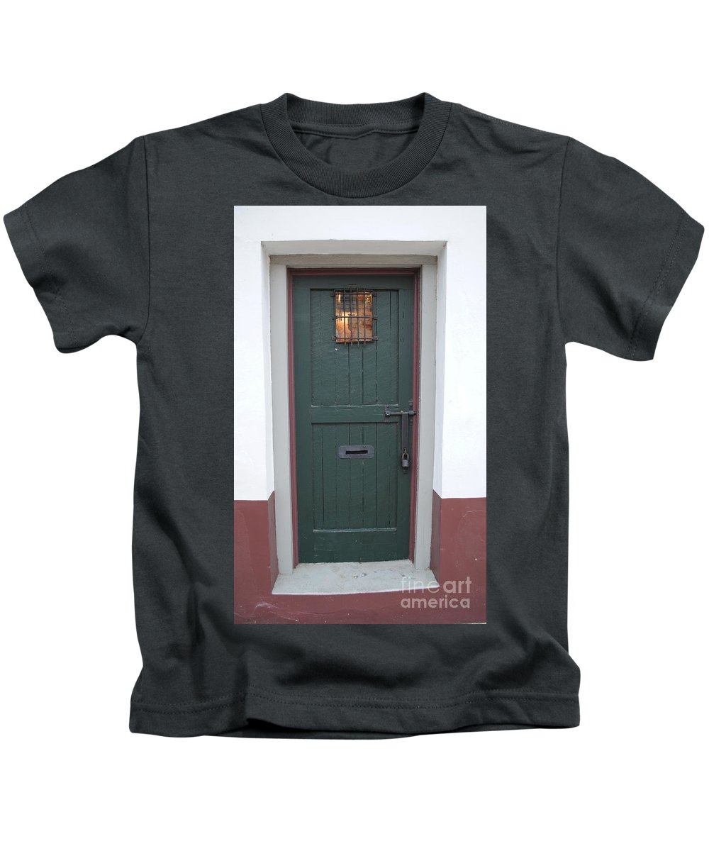 Historic Kids T-Shirt featuring the photograph The Green Door by Jost Houk
