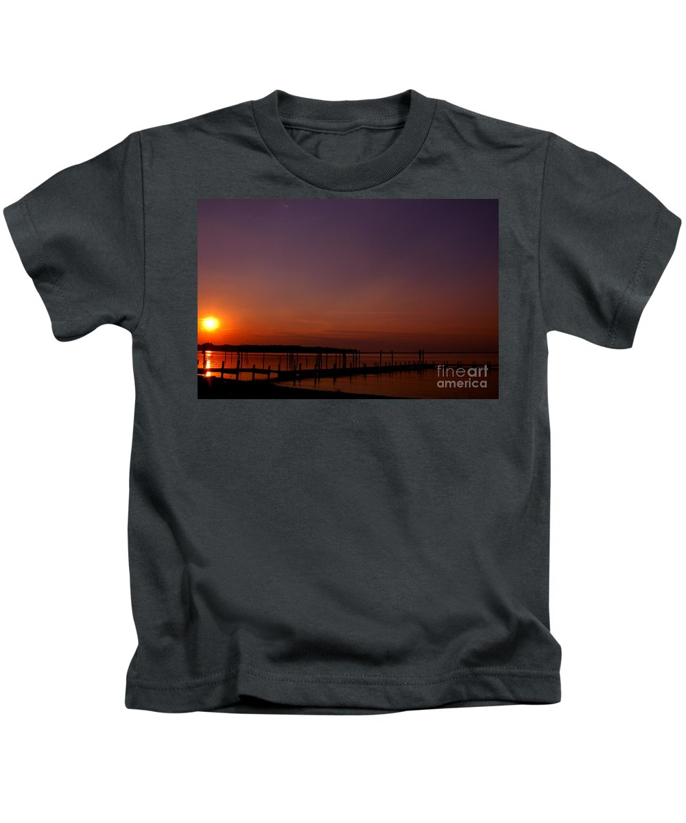 Clay Kids T-Shirt featuring the photograph The Sun Sets Over The Water by Clayton Bruster